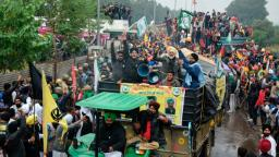 Farmers shout slogans as they take part in a march to India's capital New Delhi to protest against the central government's recent agricultural reforms, in Ambala on November 26, 2020. - Indian police fired tear gas and water cannon when they clashed with several thousand farmers marching to New Delhi to protest against recent agricultural reforms. (Photo by - / AFP) (Photo by -/AFP via Getty Images)