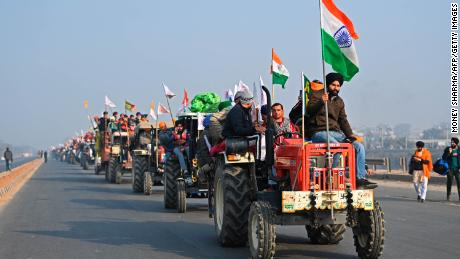 Farmers take part in a tractor rally  in New Delhi on January 26, 2021.