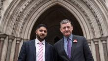 Uber drivers Yaseen Aslam, left, and James Farrar, pose outside the Court of Appeal in London in 2018.
