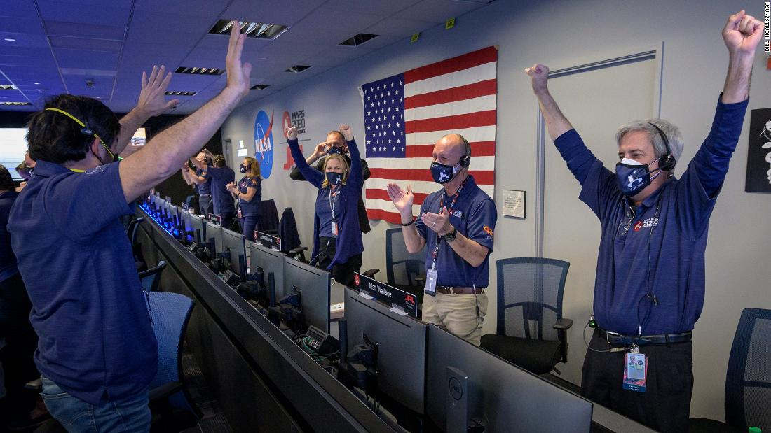 Members of NASA mission control celebrate after receiving confirmation that the rover successfully touched down on Mars on February 18.