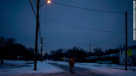 Charles Andrews walks home through his neighborhood in Waco, Texas on February 17, 2021