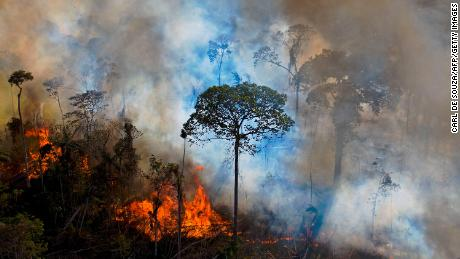 Smoke rises from an illegally lit fire in Amazon rainforest reserve, south of Novo Progresso in Para state, Brazil, on August 15, 2020.