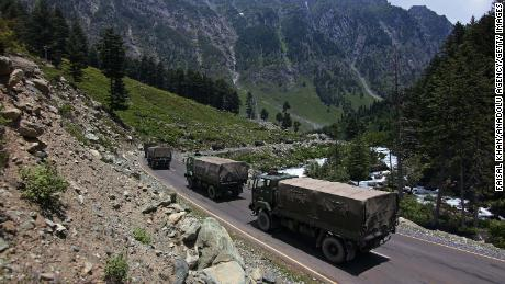 Indian army convoy moves along the Srinagar-Leh National highway towards Ladakh on June 17, 2020.At least 20 Indian soldiers were killed in a violent clash with Chinese forces in a disputed border area.