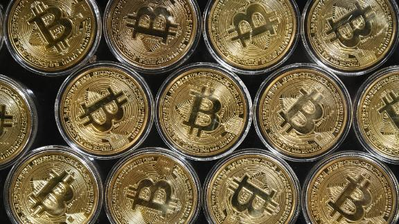 "This photograph taken on September 24, 2020 shows a physical imitation of a Bitcoin at a crypto currency ""Bitcoin Change"" shop, near Grand Bazaar, in Istanbul. (Photo by Ozan Kose/AFP/Getty Images)"