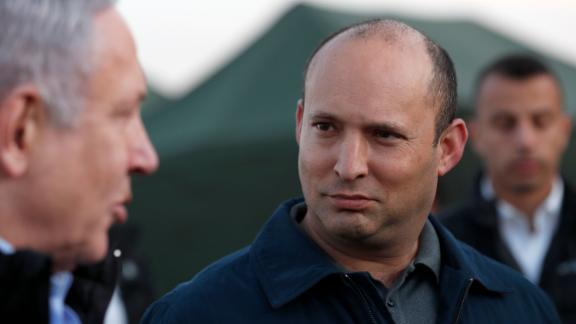 Israel's Prime Minister Benjamin Netanyahu and Defence Minister Naftali Bennett visit an army base in the Israeli-annexed Golan Heights overlooking Syrian territory, on November 24, 2019.