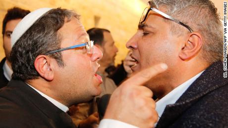 Jewish Power party's Itamar Ben Gvir argues with the Israeli Arab candidate Ata Abu Medeghem of Raam-Balad  after a hearing at the Israeli Supreme Court in Jerusalem, on March 14, 2019
