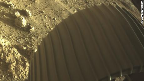 Rocks spotted by the rover have holes in them -- which has the scientists curious to see what would cause them.