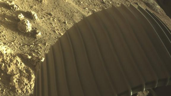 """The Twitter account for the Perseverance rover released this image. """"I love rocks,"""" the tweet said. """"Look at these right next to my wheel. Are they volcanic or sedimentary? What story do they tell? Can't wait to find out."""""""