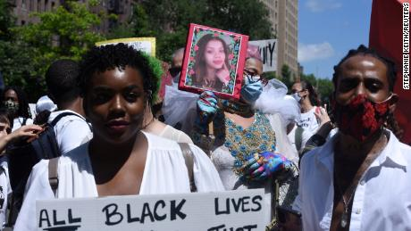 A person holds up a picture of Layleen Polanco, a transgender woman who died at the Rikers Island prison, during a Black Trans Lives Matter rally in New York City last summer.