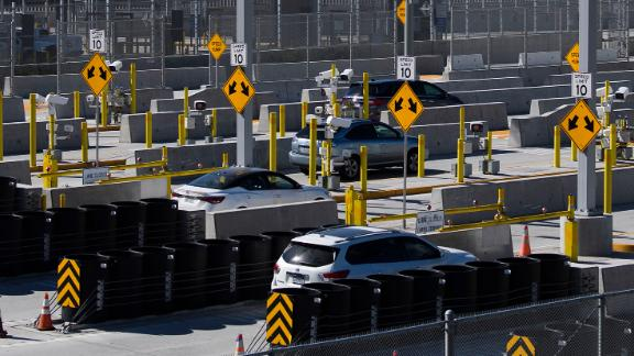 Vehicles enter a checkpoint as they approach the Mexico border at the US Customs and Border Protection San Ysidro Port of Entry at the US- Mexico border on February 19, 2021, in San Diego.