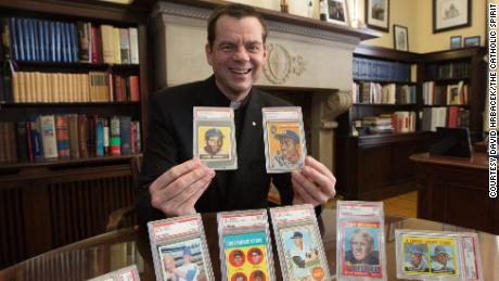 Father John Ubel is auctioning off his 50 most valuable baseball cards