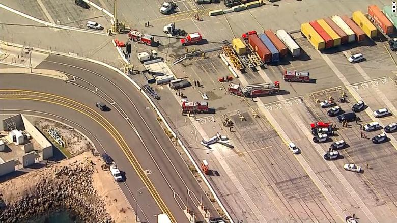 At least 1 person killed after small plane crashes into rig near Port of Los Angeles