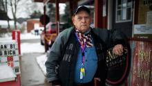 Charlie Selzer, 78, stands outside of the River Styx Market which he owns in Medina, OH on February 18, 2021.