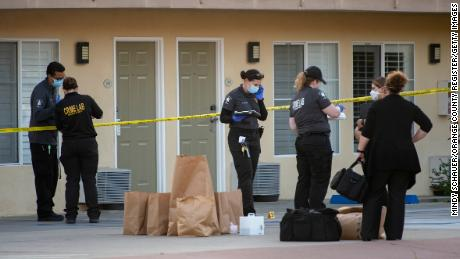 Investigators bag evidence from the scene outside the Hotel Miramar in San Clemente where Reinhold was shot and killed by deputies on Wednesday, September 23, 2020.