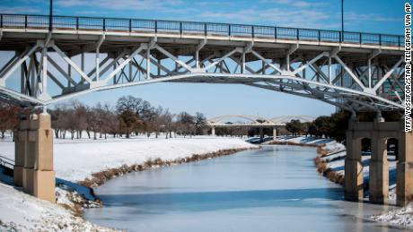 The Trinity River is mostly frozen after a snow storm Monday, Feb. 15, 2021, in Fort Worth, Texas.