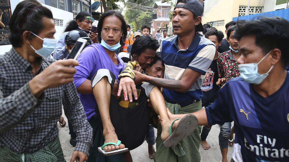 A man is carried after police dispersed protesters in Mandalay on February 20.