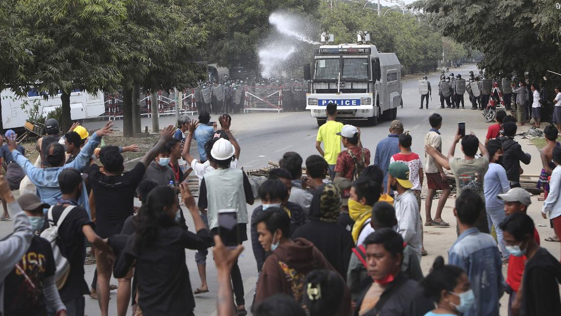 A police truck uses a water cannon to disperse protesters in Mandalay on February 20.