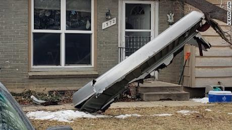 Debris from the aircraft landed outside a home in Broomfield, Colorado, on Saturday.