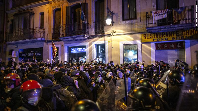 Violent protests over rapper's arrest and accusations of police brutality rock Catalonia for fifth day