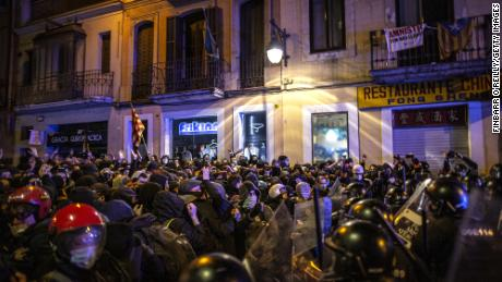 Protesters face off against a line of riot policeman in Barcelona during clashes on the fifth night of violent demonstrations condemning the arrest of rap artist Pablo Hasel