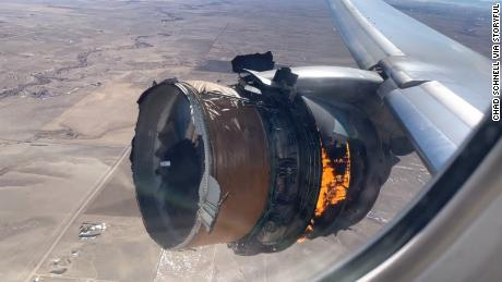 A video taken inside the plane by a passenger shows flames coming from the engine.