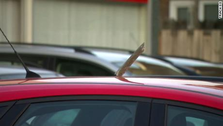 A piece of debris on a car after pieces of metal fell from a Boeing 747 cargo plane on Sunday, February 21, 2021.