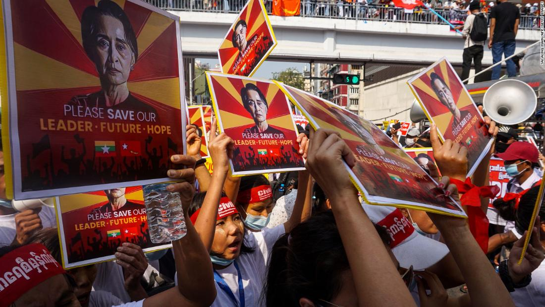 Protesters hold signs featuring civilian leader Aung San Suu Kyi during a demonstration in Yangon on February 22.