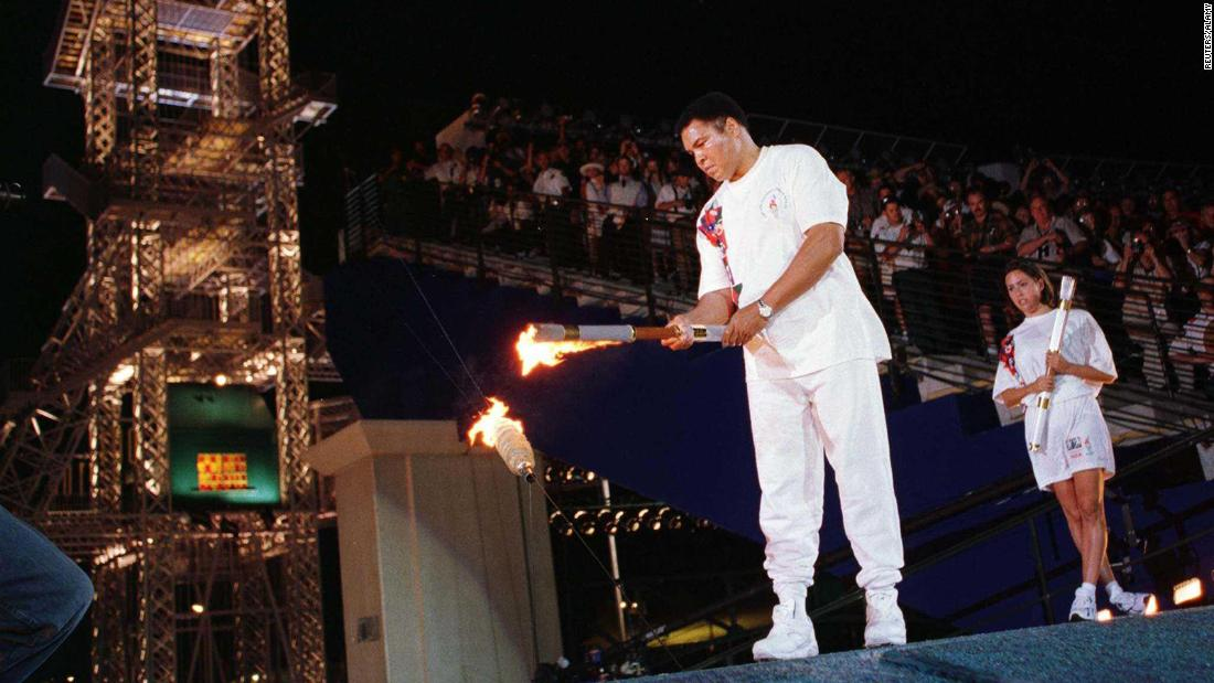 July 19, 1996 -- After developing Parkinson's disease and withdrawing from the public eye, Ali lit the Olympic cauldron, appearing as the secret final torchbearer for the Games in Atlanta.