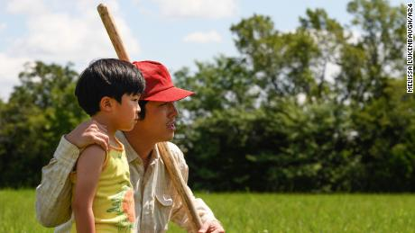 "Steven Yeun plays famiy patriarch Jacob Yi in ""Minari."" Allen S. Kim plays his son, David."