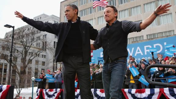 MADISON, WI - NOVEMBER 05:  U.S. President Barack Obama and rocker Bruce Springsteen wave to a crowd of 18,000 people during a rally on the last day of campaigning in the general election November 5, 2012 in Madison, Wisconsin. Obama and his opponent, Republican presidential nominee and former Massachusetts Gov. Mitt Romney are stumping from one