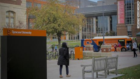 Students walk the campus on Syracuse University in New York in November 2019.