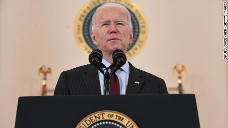 US President Joe Biden speaks about lives lost to Covid after death toll passed 500,000, in the Cross Hall of the White House in Washington, DC, February 22, 2021.
