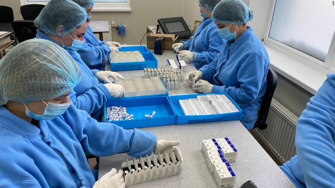 Vials of vaccine are packed at the Generium Pharmaceutical plant, which is gearing up production of Sputnik V.