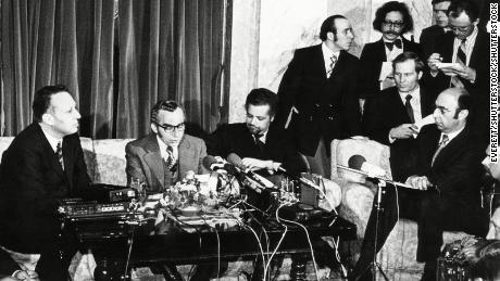 Oil ministers including Ahmed Zaki Yamani (seated, with moustache and beard) announce OPEC is lifting the oil embargo against the United States.