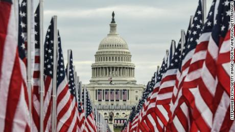The Capitol building is seen surrounded by American flags on the National Mall on January 19, 2021.
