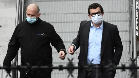 Simon Bowes-Lyon, the the Earl of Strathmore, (right) leaves court after being sentenced to jail on Tuesday.