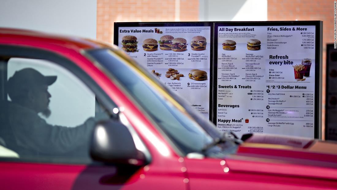 A customer views a digital menu at the drive-thru outside a McDonald's restaurant in Peru, Illinois.