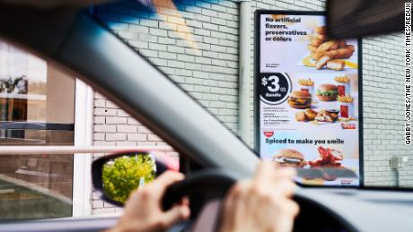 Customers order food at a digital menu board at a McDonald's in Brooklyn, New York.