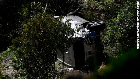The vehicle driven by Woods lies on its side in Rancho Palos Verdes, California.