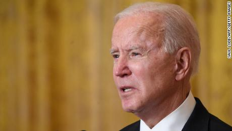 Biden marks 50 million doses of vaccine, but warns of