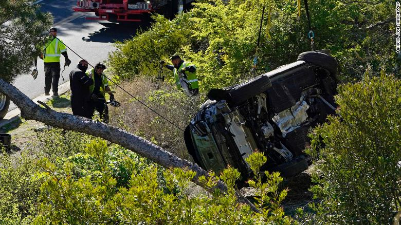A vehicle rests on its side after a rollover accident involving golfer Tiger Woods Tuesday.