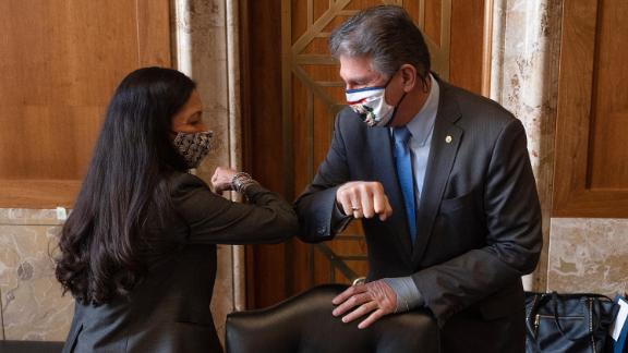 Chairman Joe Manchin (C), D-WV, greets Congresswoman Deb Haaland, D-NM, during the Senate Committee on Energy and Natural Resources hearing on her nomination to be Interior Secretary on February 23, 2021 in Washington, DC. If confirmed, Haaland would become the first Native American Cabinet secretary in U.S. history.