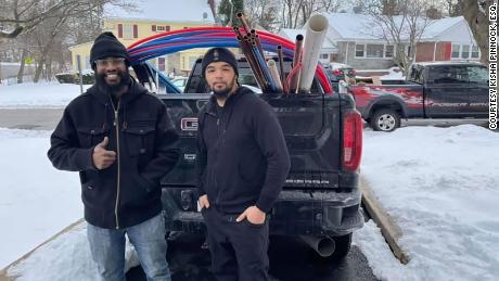 New Jersey plumber Andrew Mitchell, right, and his apprentice Isaiah Pinnock have been working in the Houston, Texas, area since Sunday because local plumbers have been overwhelmed with calls.