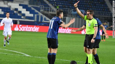 German referee Tobias Stieler shows a red card to Atalanta's Remo Freuler.