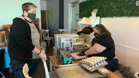 Bakery co-owners Janessa and Jessica Tomberlin prepare food to give away at Crema Bakery on February 23, 2021.