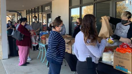 Owner Janessa Tomberlin hands out free food at Crema Bakery in South Austin on February 23, 2021