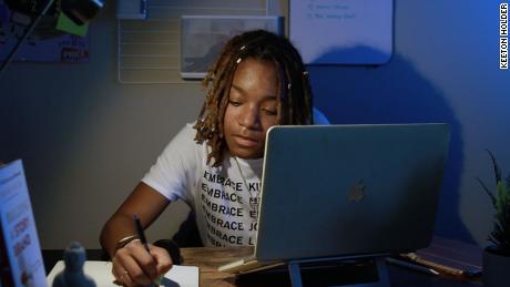 Kearra Johnson, owner of Studio Lo, working at her desk.