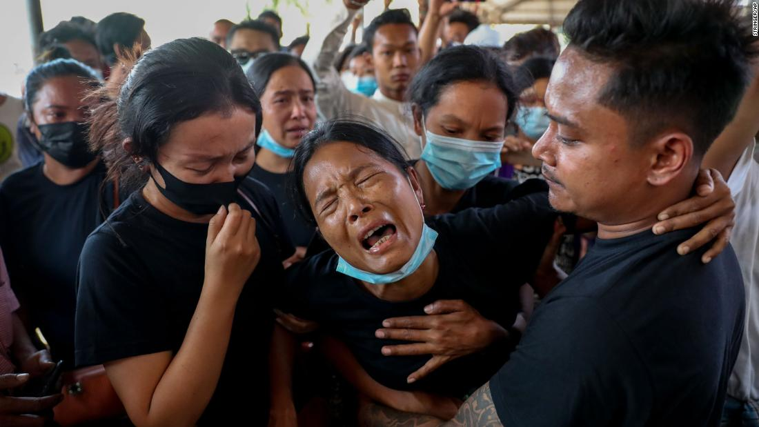 "Thida Hnin cries during the funeral of her husband, Thet Naing Win, in Mandalay on February 23. He and another protester <a href=""https://www.cnn.com/2021/02/20/asia/myanmar-police-protestors-reports-shooting-intl/index.html"" target=""_blank"">were fatally shot by security forces</a> during an anti-coup protest."