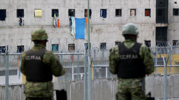 Soldiers stand guard outside the CRS Turi prison in Cuenca, Ecuador on February 24, 2021. - At least 79 inmates died in simultaneous riots blamed on gang warfare at four prisons in Ecuador, officials said Wednesday. (Photo by FERNANDO MACHADO / AFP) (Photo by FERNANDO MACHADO/AFP via Getty Images)
