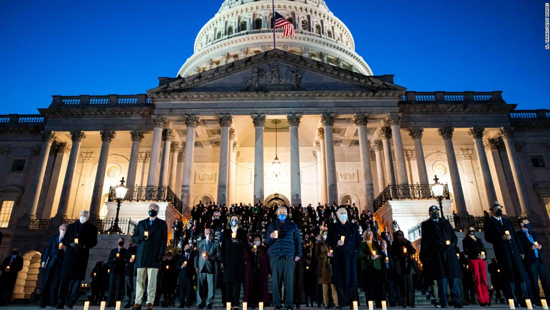 "Members of Congress observe a moment of silence on the steps of the US Capitol on February 23. At that point, <a href=""https://www.cnn.com/interactive/2021/health/covid19-us-deaths-memorial/"" target=""_blank"">more than 500,000 Americans</a> had lost their lives to Covid-19."